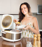 Woman cooking with new electric multicooker Royalty Free Stock Photography