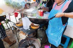Woman Cooking Noodle Soup Outdoors On Traditional Street Market In Asia Food Preparing On Open Bazaar. Culture And Traditions Concept Stock Photos