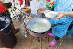 Woman Cooking Noodle Soup Outdoors On Traditional Street Market In Asia Food Preparing On Open Bazaar. Culture And Traditions Concept Royalty Free Stock Images