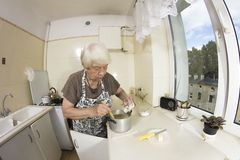 Woman cooking a pancakes at home. Royalty Free Stock Photo