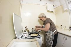 Woman cooking a pancakes at home. Stock Photography