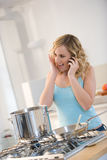 Woman cooking pasta Stock Photography