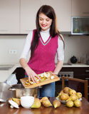 Woman cooking pear jam Royalty Free Stock Photo