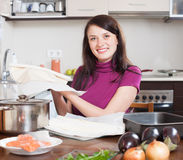 Woman cooking pie with salmon Royalty Free Stock Photo