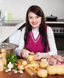 Woman cooking potatoes with  meat Royalty Free Stock Photography