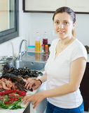 Woman cooking produce from the sea Stock Photography