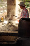 Woman cooking rice paste to make rice noodles, vietnam