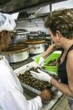 Woman cooking Stock Photos