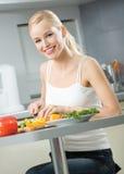 Woman cooking salad Stock Photos