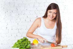 Woman cooking salad Royalty Free Stock Photo