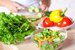 Woman cooking salad Royalty Free Stock Images