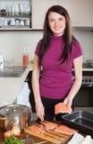Woman cooking  salmon fish Stock Image