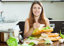 Woman cooking sandwiches with cheese Royalty Free Stock Photos