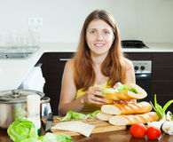 Woman cooking sandwiches with cheese and vegetables Stock Photos