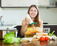 Woman cooking sandwiches with mayonnaise sauce Royalty Free Stock Image