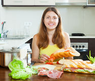 Woman cooking sandwiches with tomato and  hamon Stock Photos