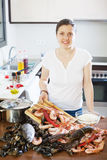 Woman cooking seafood Stock Photos