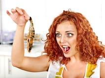 Woman cooking shrimp. Happy woman cooking shrimp Stock Photography