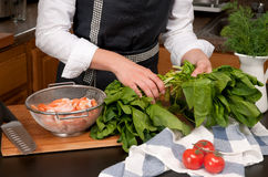 Woman cooking shrimps in the kitchen Royalty Free Stock Photo