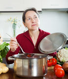 Woman cooking soup Royalty Free Stock Photo