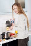Woman cooking soup Royalty Free Stock Images