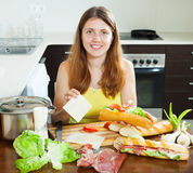 Woman cooking spanish sandwiches with cheese Royalty Free Stock Photo