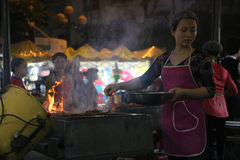A woman cooking on a stall in a night market in Hanoi Royalty Free Stock Photography