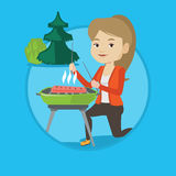 Woman cooking steak on barbecue grill. Royalty Free Stock Images
