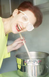 Woman cooking with steam on her glasses Royalty Free Stock Photos