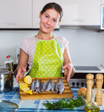 Woman cooking stew with sardines Royalty Free Stock Photo