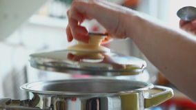 Woman, cooking. And tasting the soup stock footage