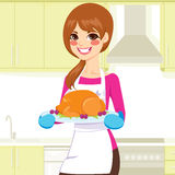 Woman Cooking Thanksgiving Turkey Royalty Free Stock Photography