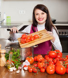 Woman cooking with tomatoes Royalty Free Stock Photography