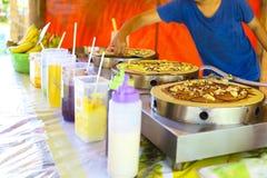 Woman cooking traditinal Thai Banana Pancake with chocolate Royalty Free Stock Images