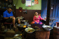Woman cooking in traditional restaurant Nepal Royalty Free Stock Photo
