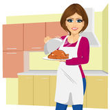 Woman cooking traditional thanksgiving turkey Stock Photos
