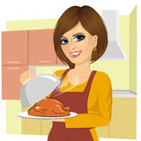Woman cooking traditional thanksgiving turkey Stock Photo