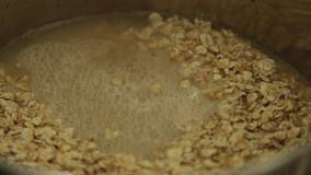 Woman Cooking Vegan Porridge Recipe set stock video footage