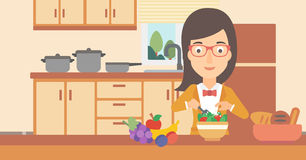 Woman cooking vegetable salad. Royalty Free Stock Photo