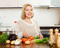 Woman cooking vegetables at home Royalty Free Stock Photography