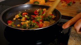 Woman cooking vegetables stock video