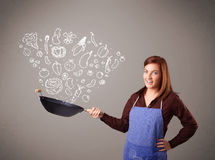 Woman cooking vegetables Royalty Free Stock Photos