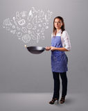 Woman cooking vegetables Royalty Free Stock Image