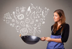 Woman cooking vegetables Stock Photo