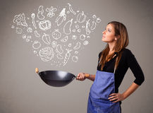 Woman cooking vegetables Stock Photos