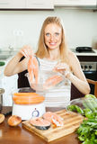 Woman cooking vegetables and salmon in  steamer Stock Images
