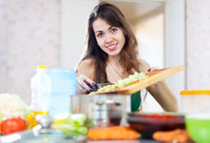 Woman cooking vegetarian dinner Royalty Free Stock Photography