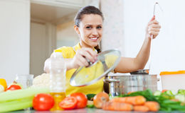 Woman cooking  vegetarian food in saucepan Royalty Free Stock Photography