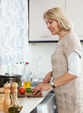 Woman cooking vegetarian soup at home Royalty Free Stock Photography