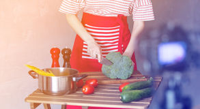 Woman cooking for Video-sharing website Royalty Free Stock Photo